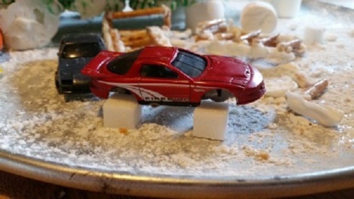 If you can, take the wheels off your toy cars and prop them up on sugar cube cinder blocks.