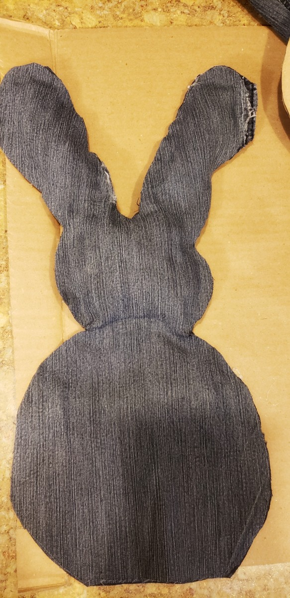 Fill your bunny's head with poly beads to the desired level of plushness. Hot glue the two sections together to create a seam.