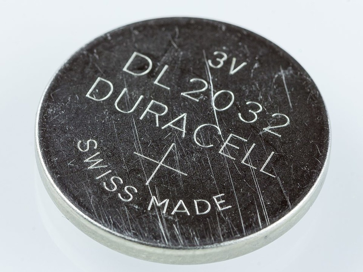 2032 3 volt lithium coin cell as used in digital watches and and electronic gadgets with a low current demand.