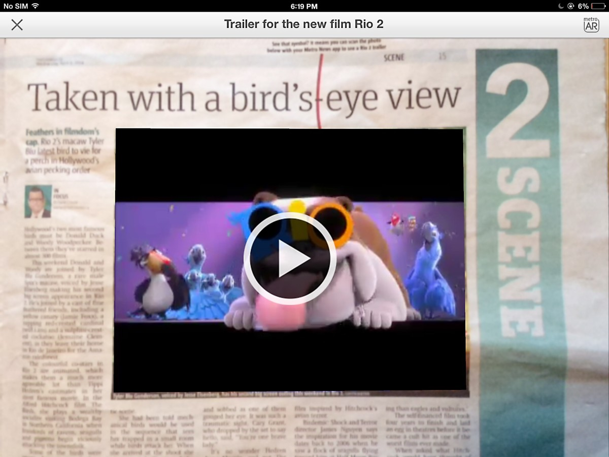 The video is superimposed on the photo, as seen on my iPad screen.