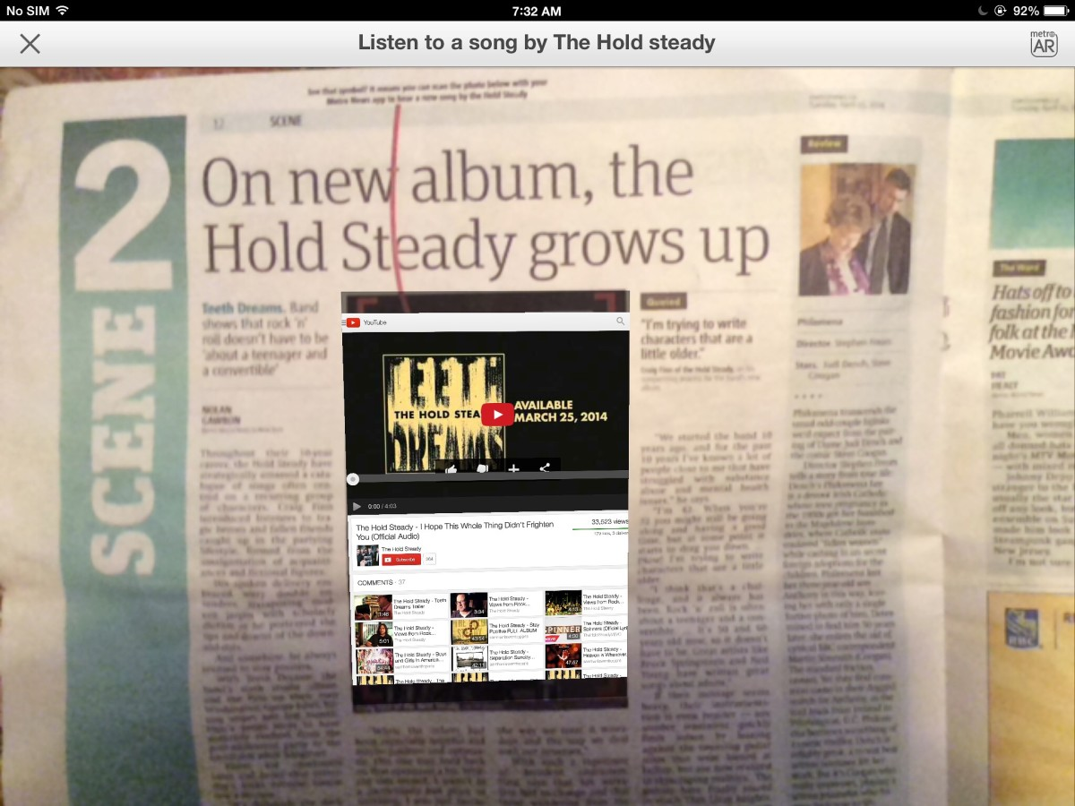 This edition of the Metro newspaper allowed someone to read an article about the Hold Steady and then listen to a sample of their latest music.