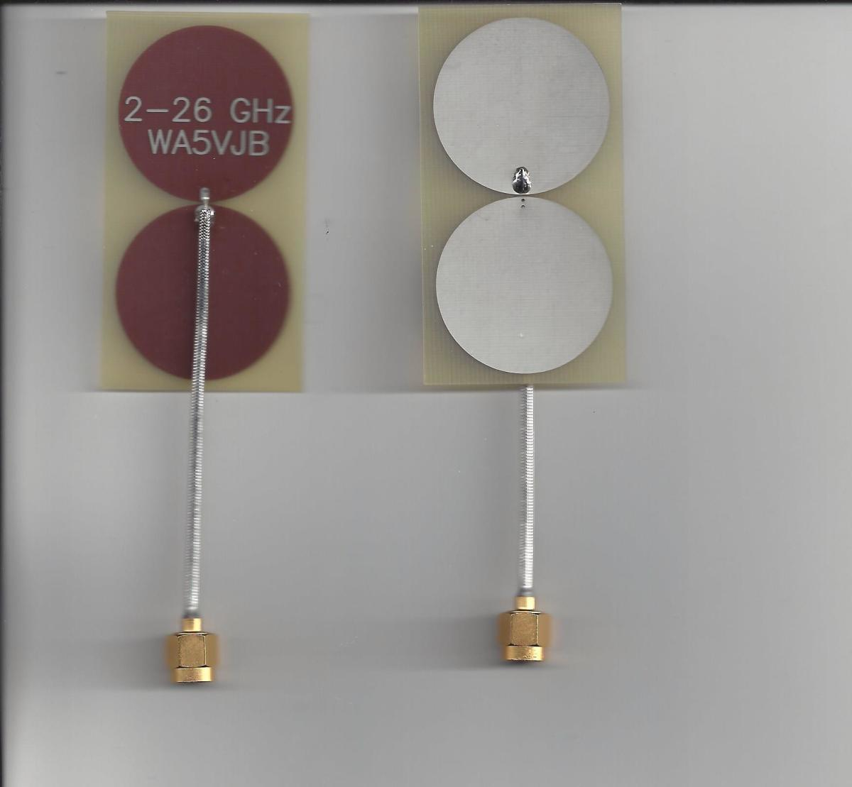 2-26 GHz antenna with a coax connector attached, shown front and back