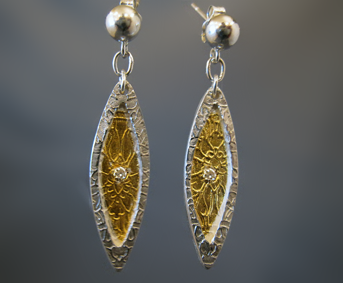 Fine silver marquise earrings with 24k gold keum-boo accents and embedded fire-in-place CZ (cubic zirconia) stones.