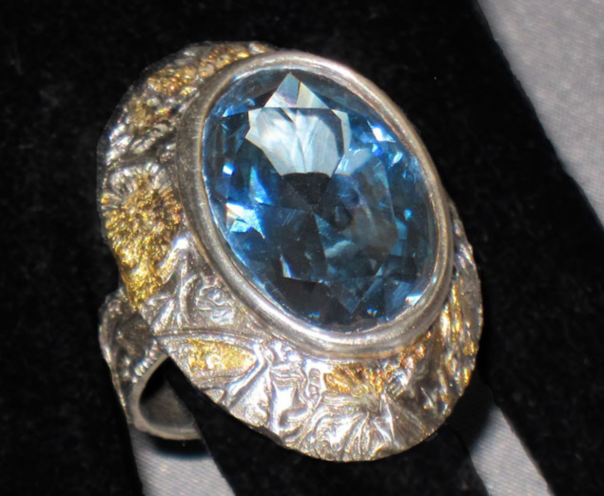 Bold fine silver cocktail ring from metal clay, set with 25 x 18 mm blue topaz CZ and embellished with 24K gold keum-boo created at a workshop taught by Barbara Becker Simon at La Ruche Davis.
