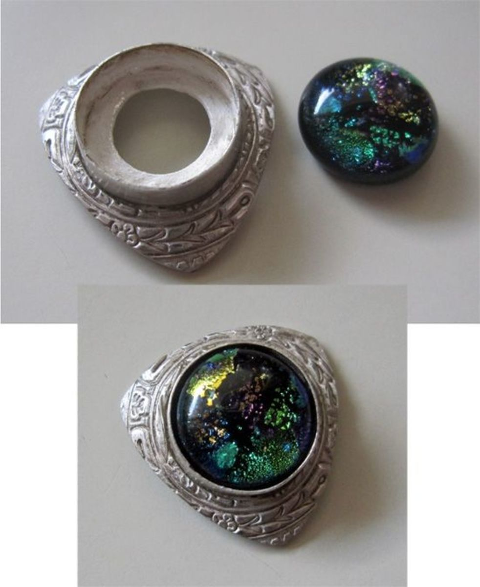 Photo: Fine silver bezel wire setting embedded in fine silver metal clay before firing and set with a dichroic glass cabochon after firing, designed, created and photographed by Margaret Schindel, all rights reserved.