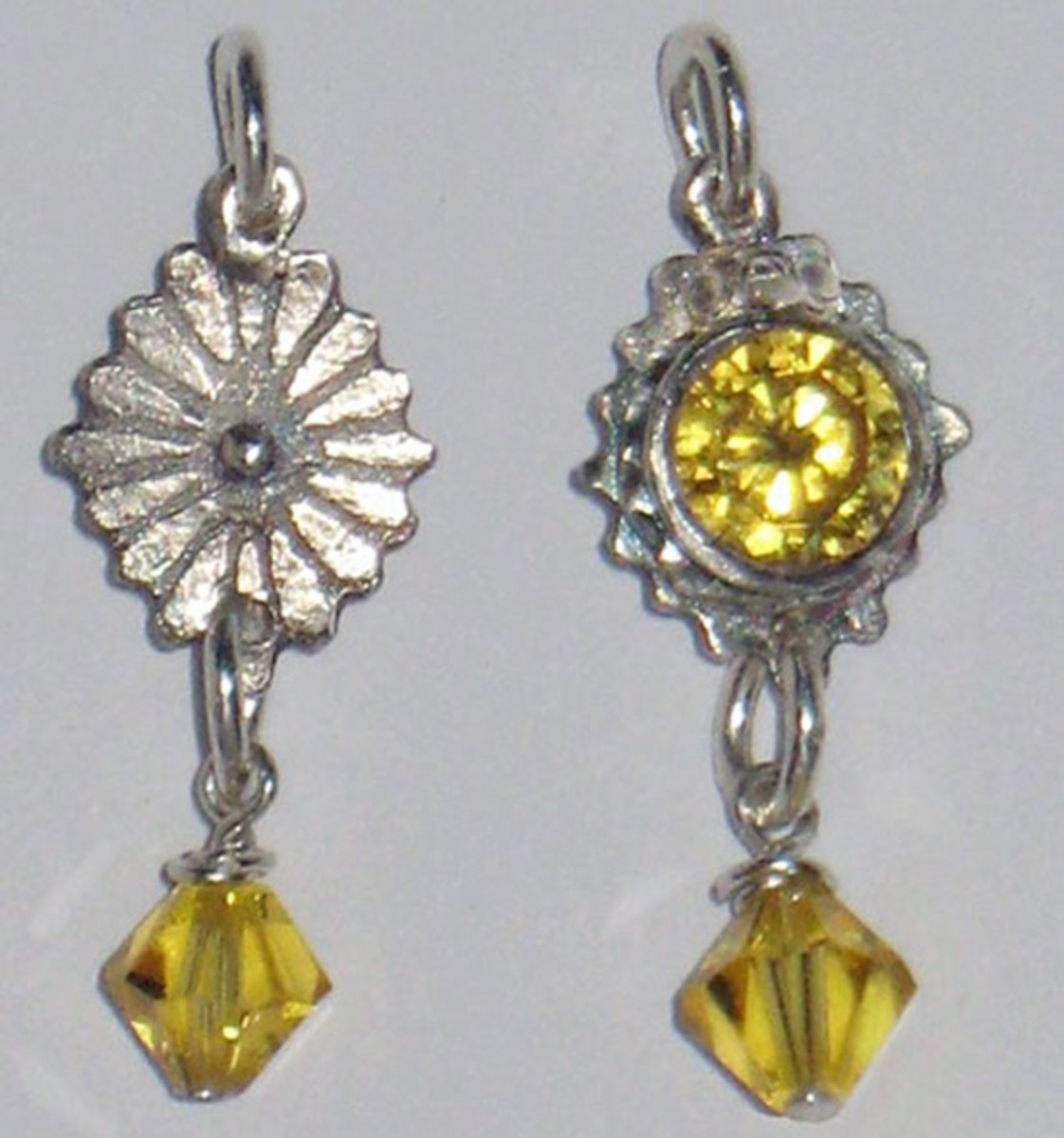 Photo: Fine silver charm (both sides shown) from metal clay, set with a tall citrine CZ and embellished with a crystal bead drop, designed, created and photographed by Margaret Schindel, all rights reserved.