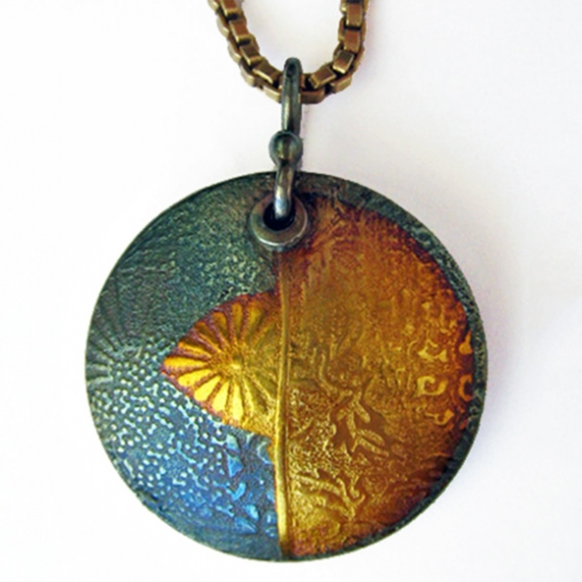 Fine silver PMC lentil pendant with 24k gold foil keum-boo and iridescent LOS patina. Front textured with a tear-away texture made from collaged images.