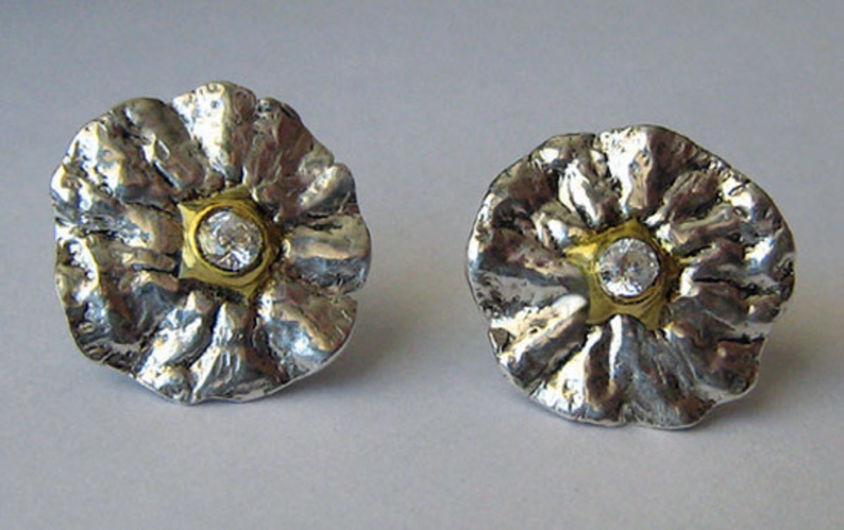 Fine silver, 22k gold and cubic zirconia earrings molded from the stem end of a tangerine