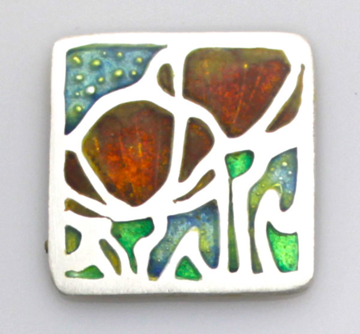 Silver metal clay impressed with a deep-relief texture created with a Silhouette CAMEO on Scratch-Foam, then fired and filled with enamel.