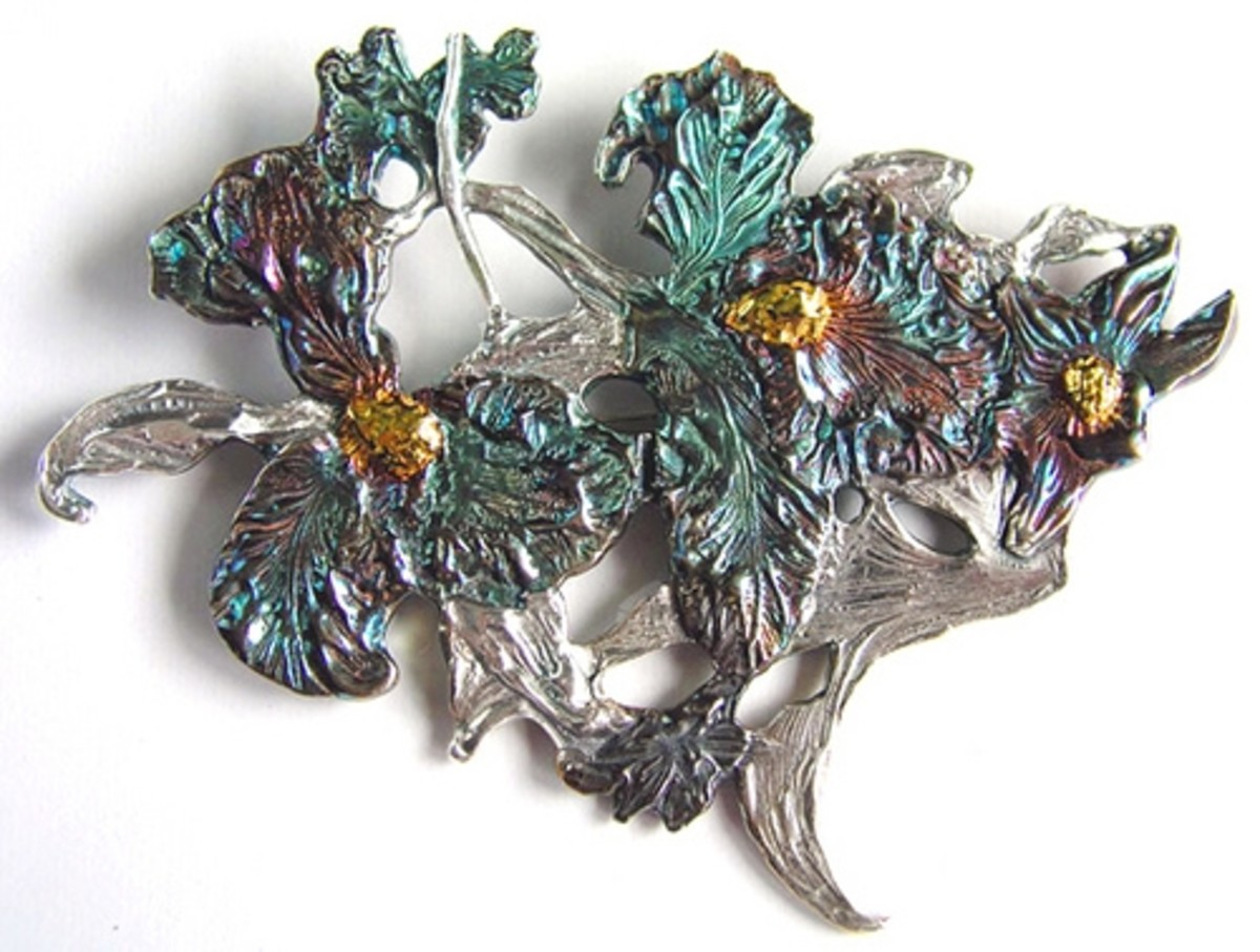 Fine silver large iris brooch constructed from multiple layers of PMC components each each pressed into a detailed botanical rubber stamp. Embellished with 24k gold (Accent Gold for Silver), petals colored with an iridescent liver of sulfur (LOS) pat