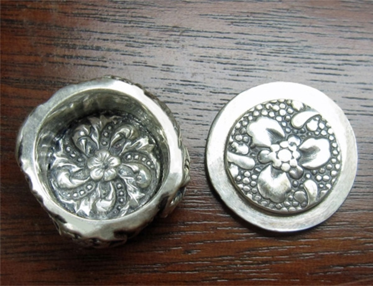 Fine silver lidded box - open, top view. Textures shown inside bottom of box and lid stopper made with antique button mold textures from Cool Tools.