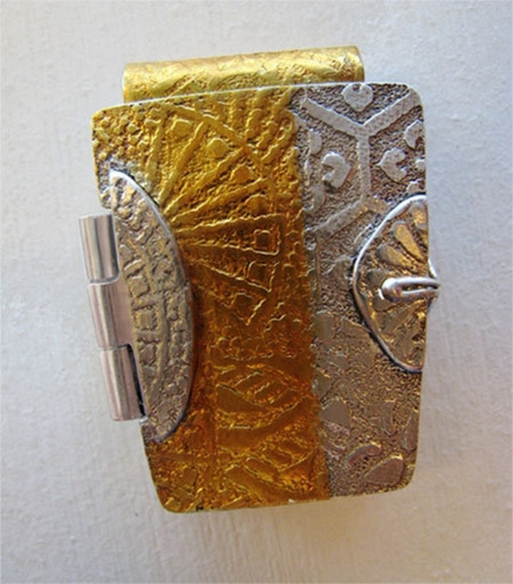 Attaching hinges is a perfect application for using homemade metal clay oil paste, as I did on this hinged fine silver and gold locket made from PMC3 silver clay and 24K gold keum-boo foil.