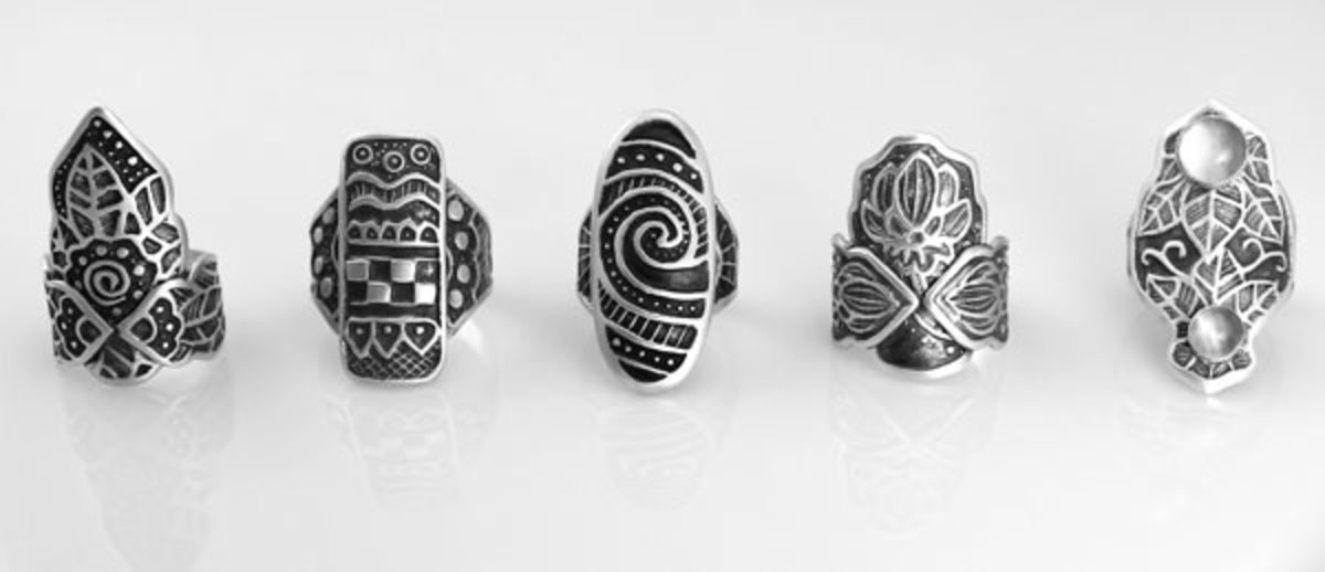 Sterling silver shield rings by Wanaree Tanner.  PMC Sterling silver clay textured with original designs hand-embossed into Scratch-Foam. used by permission of the artist;