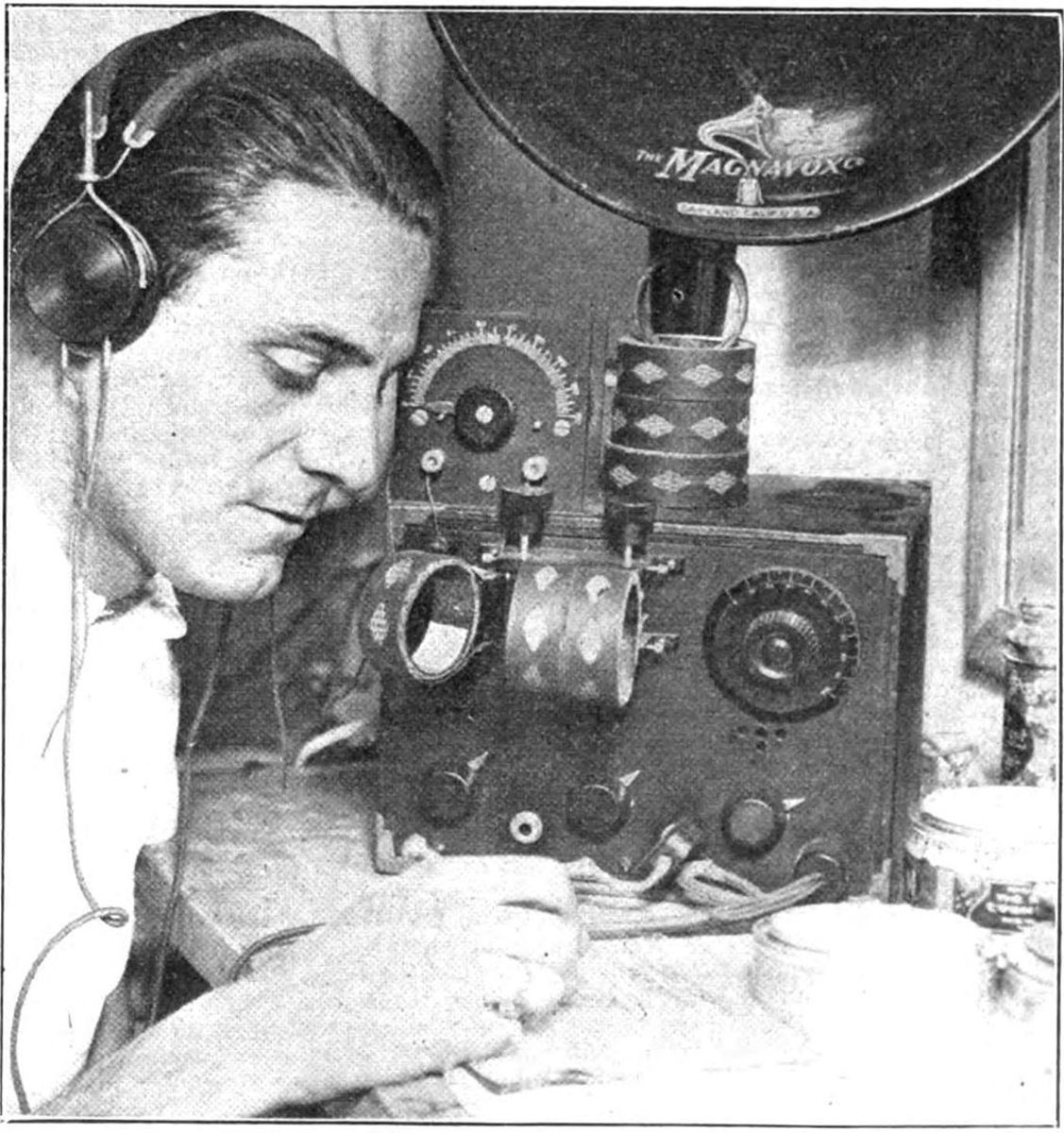 Man using early headphones in 1922.