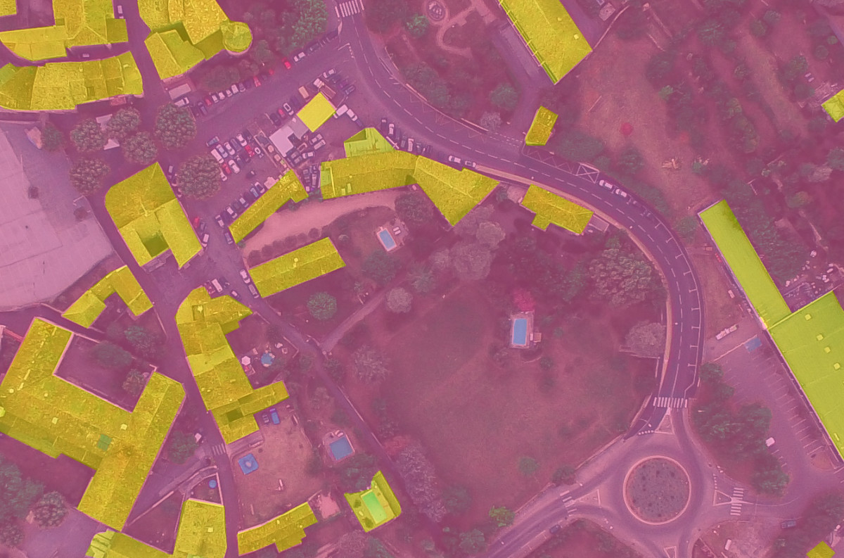 Image classification techniques were also used to find buildings in this image. It's not perfect but I'd say it's pretty good.