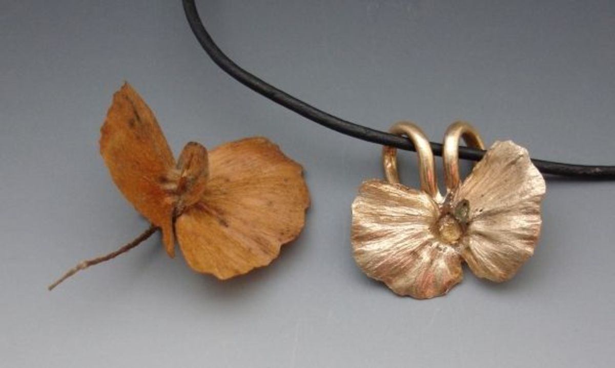 Bronze butterfly pendant with pod
