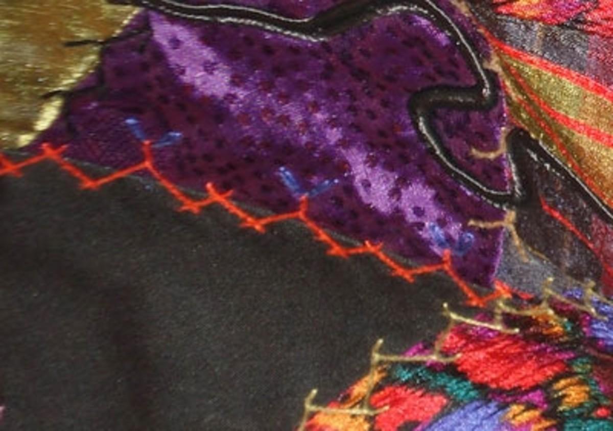 Herringbone stitch with cretan stitch and chain stitch between.