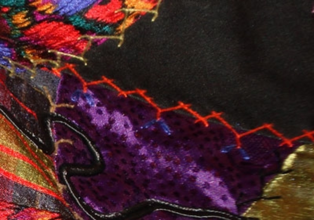 Pretty stitching (by hand or machine) embellishes crazy patchwork.