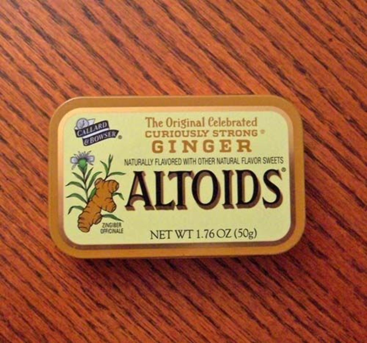 A smooth ginger Altoids tin found under my sink