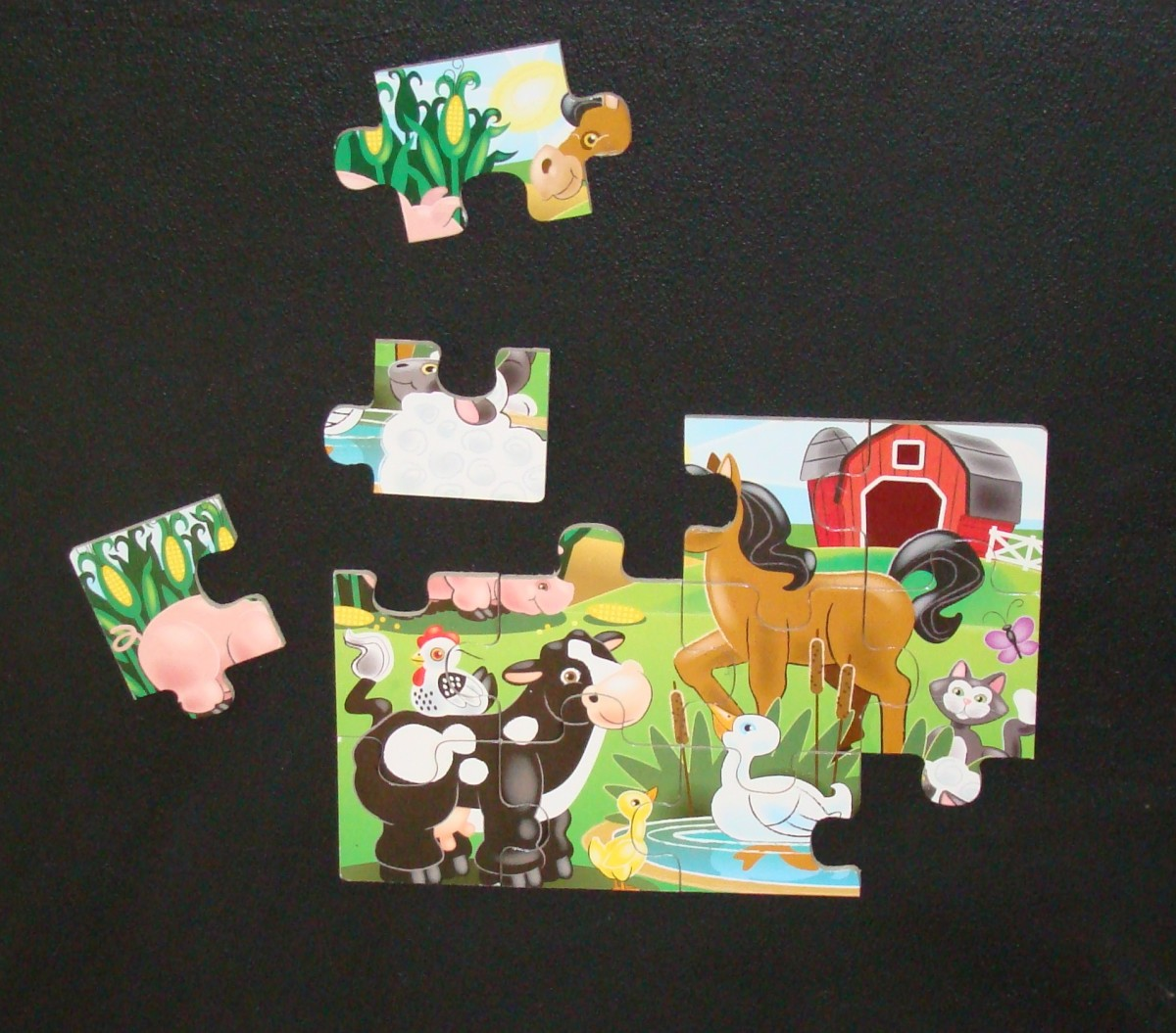 The wooden Melissa and Doug Fresh Start Puzzle up on the wall.