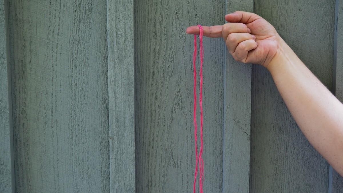 Fold the five strings in half. (thus creating ten strings).