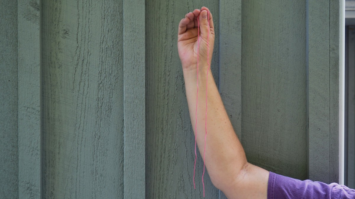Measure the string from fingertips to elbow.