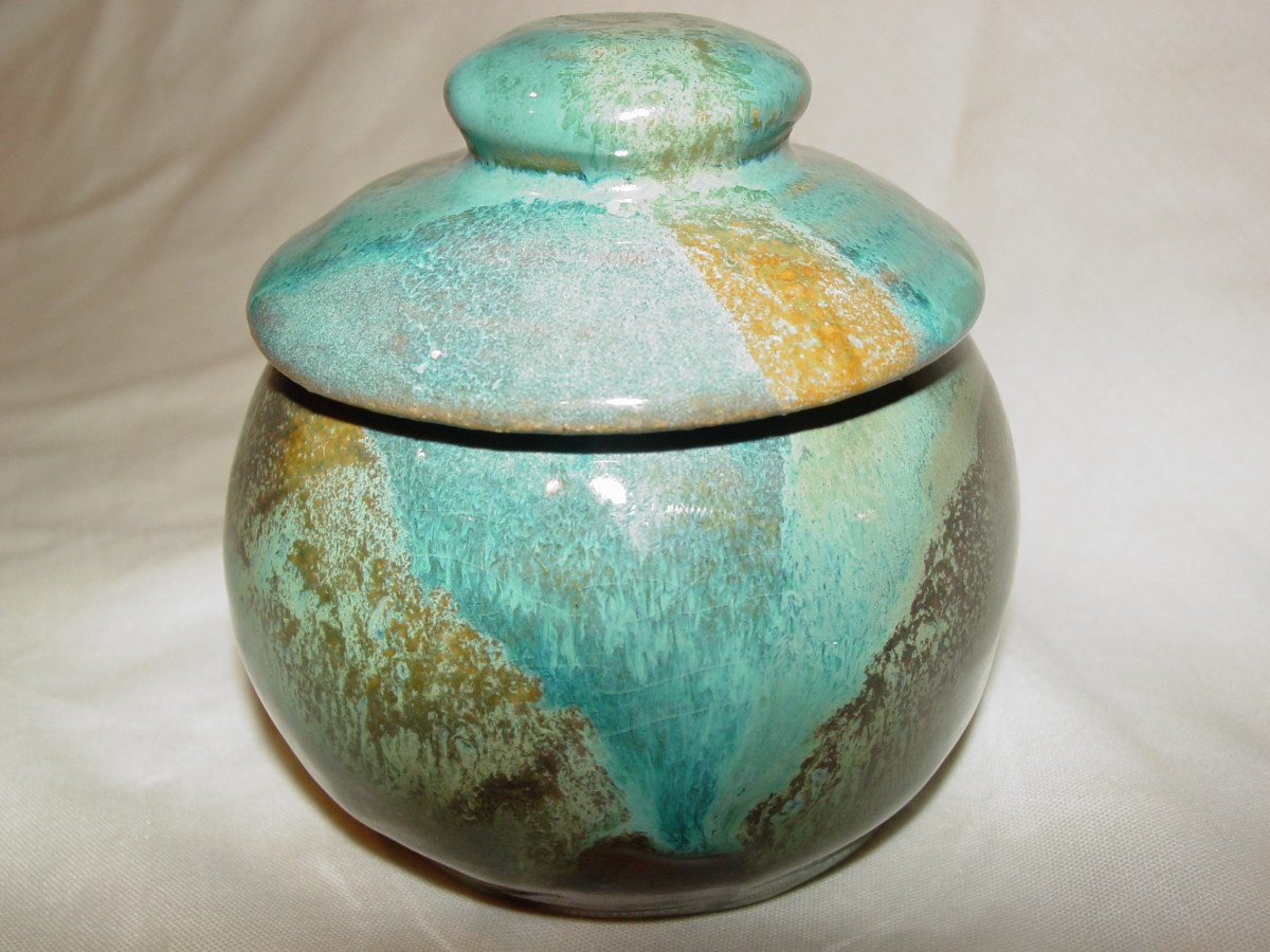 small green jar with lid