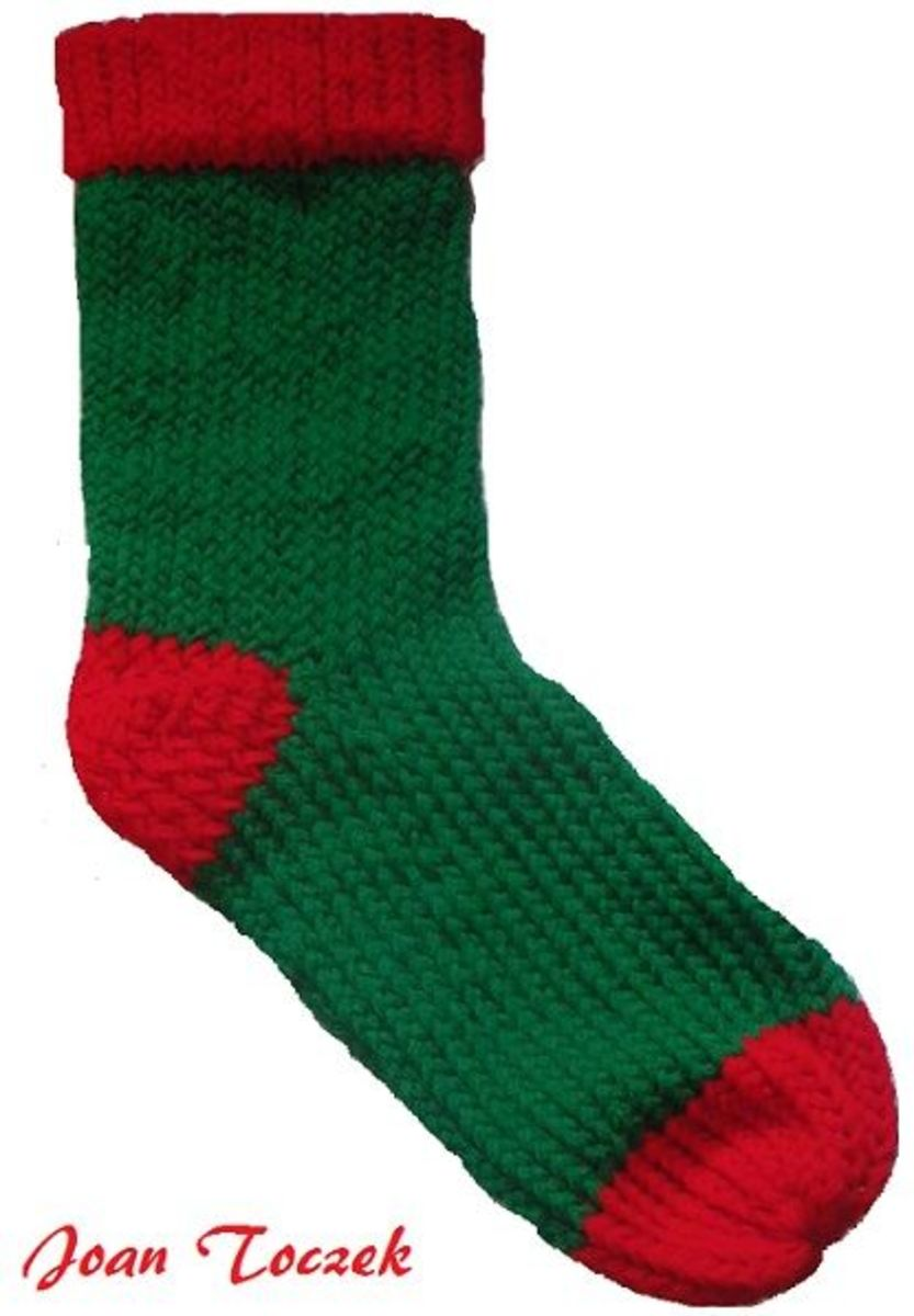 Joan Toczek submitted this photo of the finished Christmas stocking done on the red round Knifty Knitter loom.