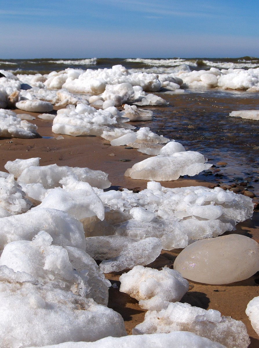Perspective of ice melt from banks of Pier Cove Creek emptying into Lake Michigan