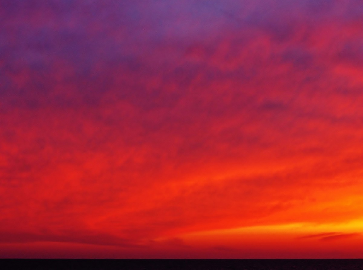 Red Cloud Vortex at Pier Cove Beach on Lake Michigan