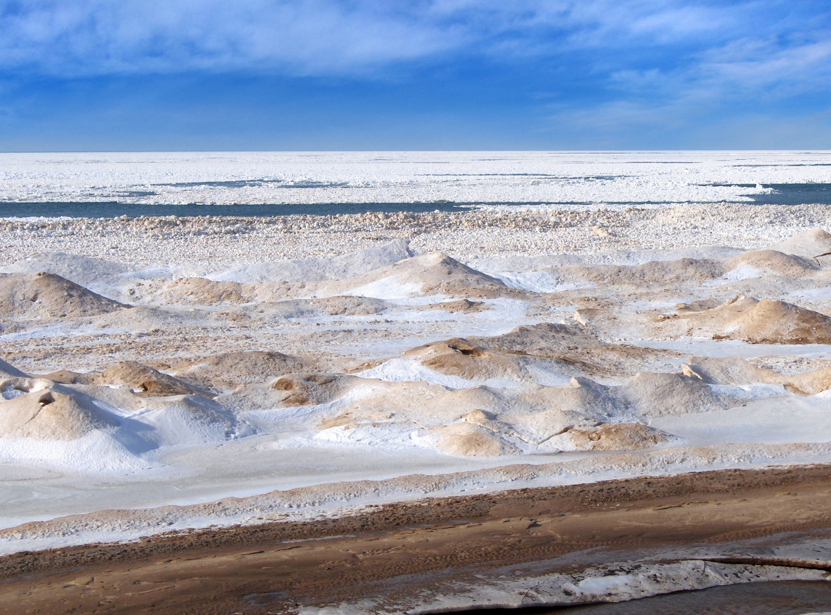 Lake Michigan Ice Shelf in the beginning stages of a melt down; view from Pier Cove's beach bluff