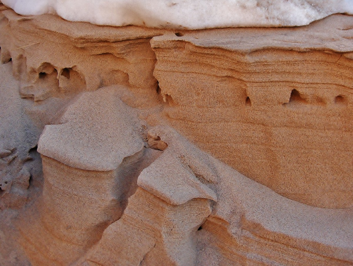 Frozen sand sculptures along banks of Pier Cove Creek