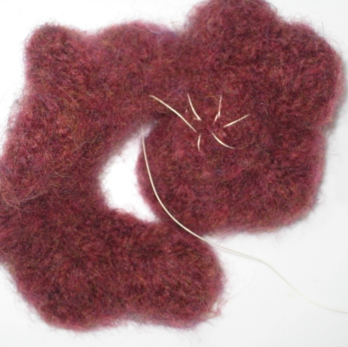 Felted flower stitching bottom edge
