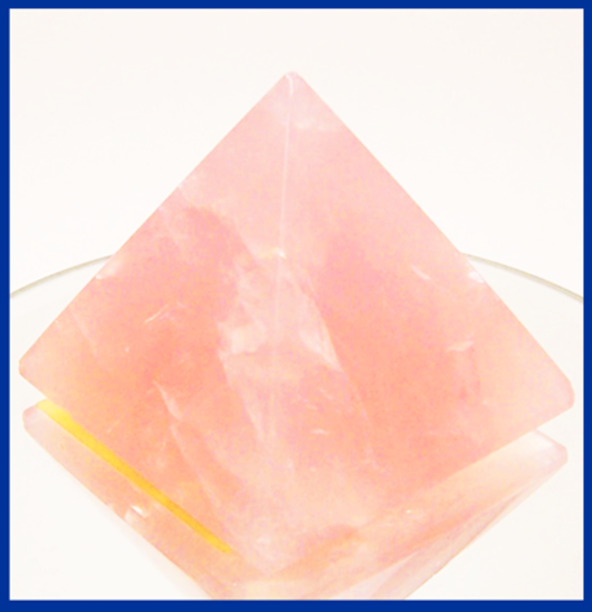 Product Photo 2.  Enhanced & cropped product photo of rose quartz pyramid,