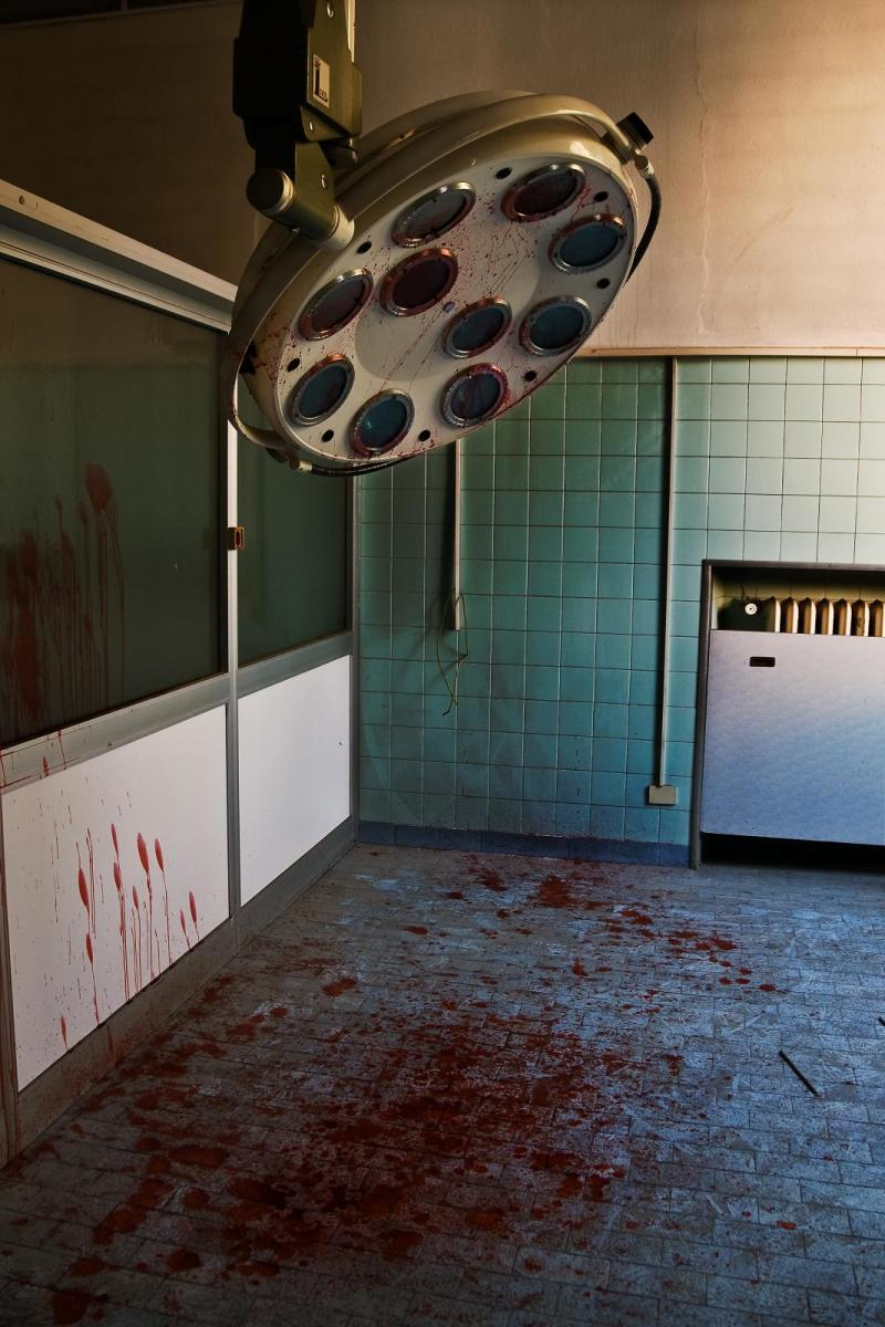 With the splashes of blood upon these walls, floor and overhead light, one must wonder:  was this surgery gone terribly wrong, or is it your gory imagination?