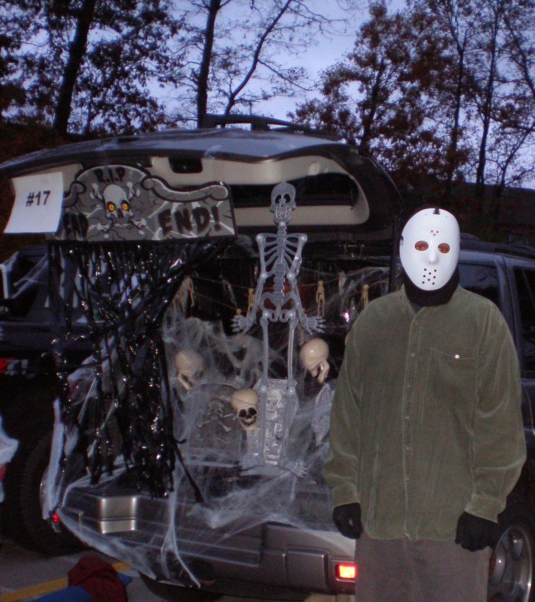 This adult dressed up as Jason Voorhees for Halloween and became a prop in his Trunk or Treat display.