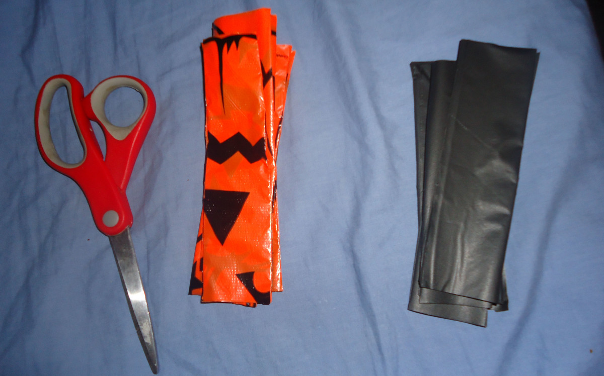 Orange and black strips cut from plastic tablecloths.