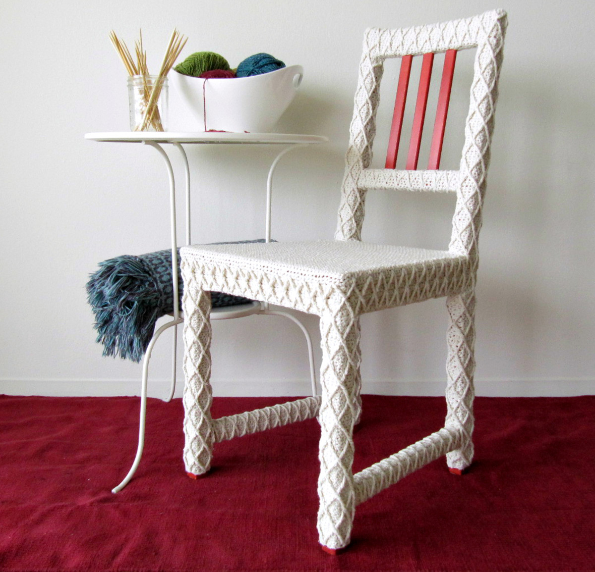 Reclaimed chair upholstered with 100% recycled yarn using yarn bombing technique.