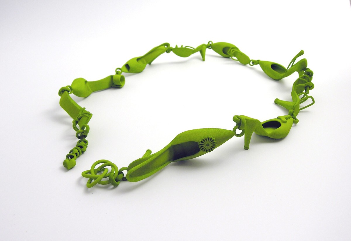 This 3D printed bracelet is composed of shoes and created by a jewelry designer. It may have been created by a more advanced printer than a consumer-oriented one.