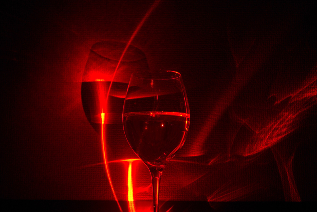 You can make some striking visuals using the laser pointer with some water in a glass.