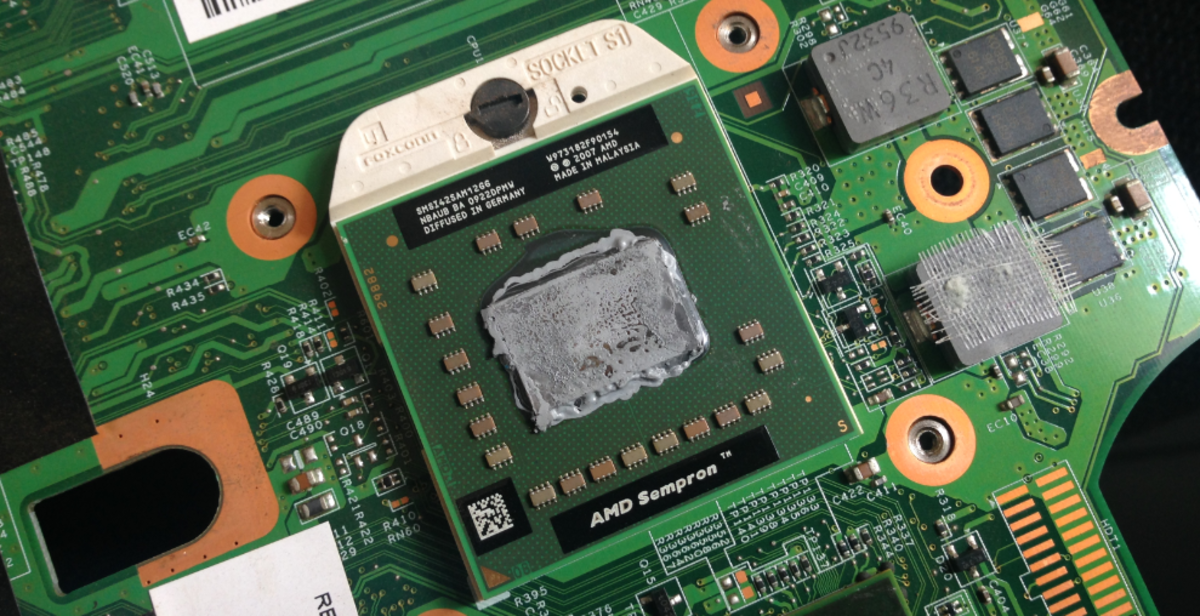 An AMD microprocessor, inserted onto a laptop motherboard socket