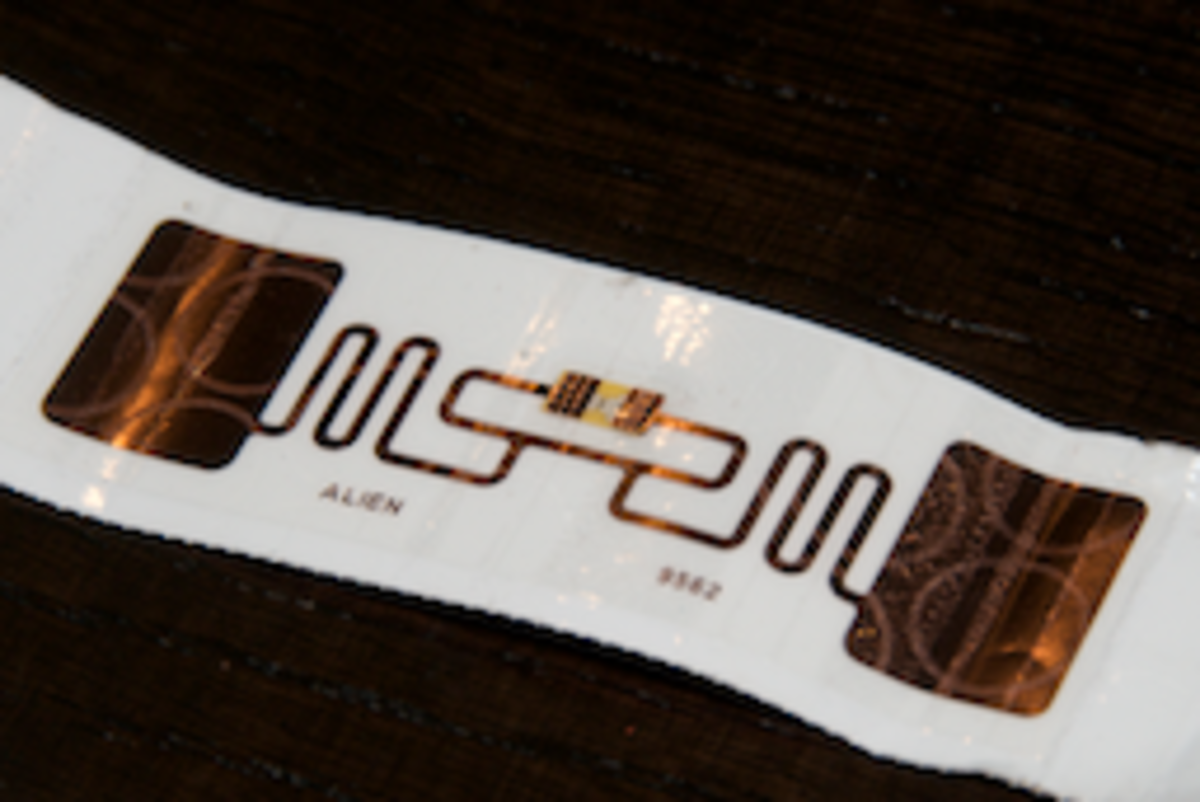 The photo shows the back side of a disposable tag used for race timing.