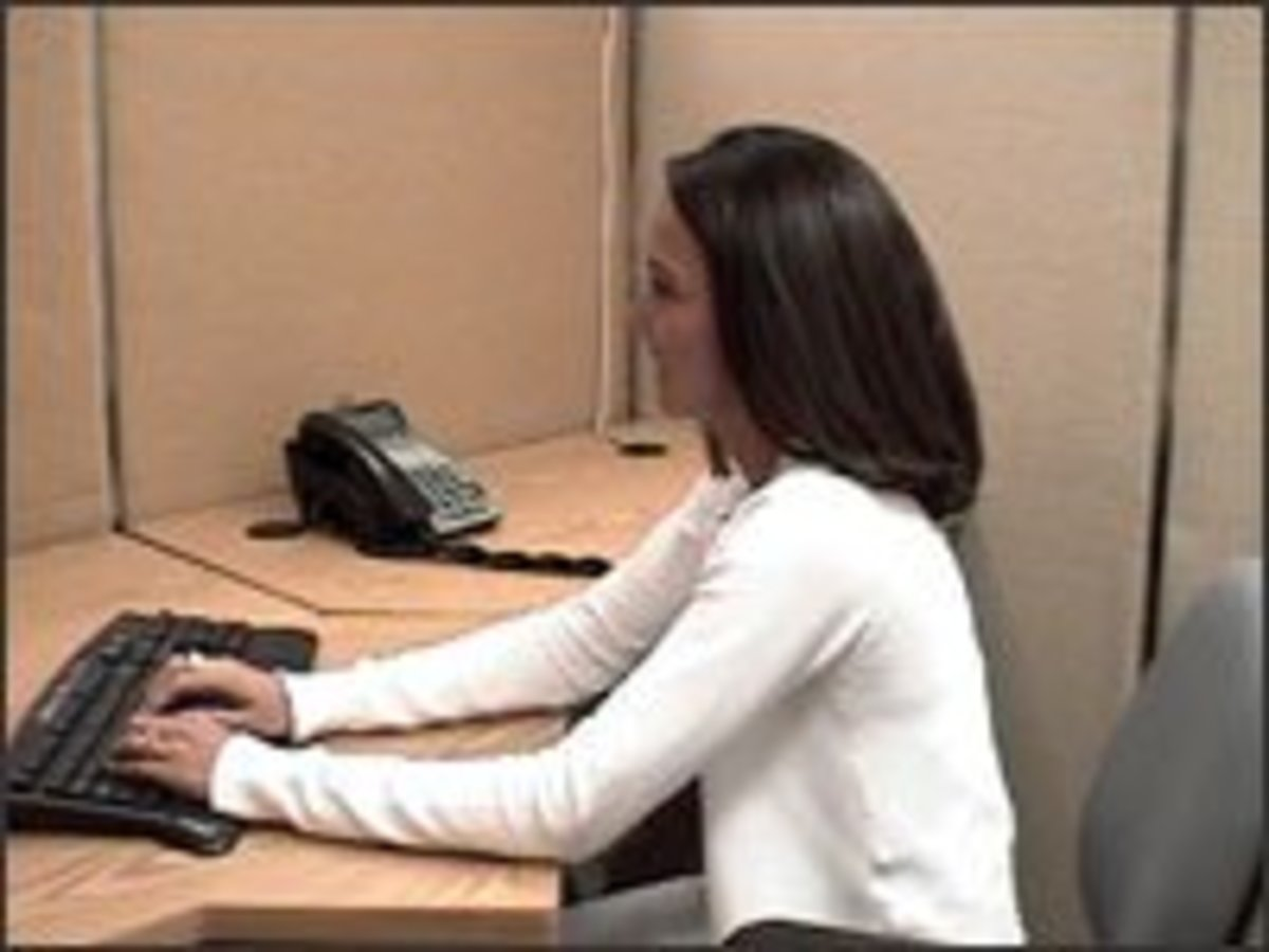 Improper placement of your keyboard can lead to musculoskeletal disorders or MSDs. In this picture the keyboard is awkwardly placed too far way from the worker.