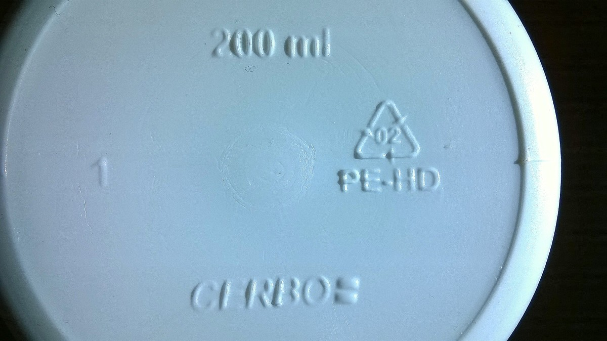 Plastic recycling/identification code embossed onto the underside of a medicine bottle