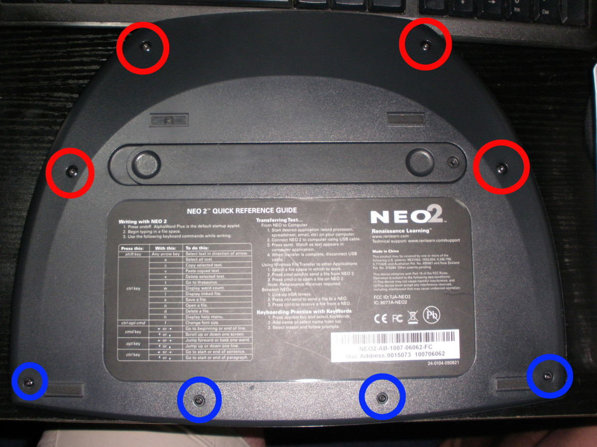 Remove the four T10 screws that are circled in red, as well as the four T6 screws circled in blue.  The battery door screw doesn't need to be removed on the Neo2 to take the back panel off, mine was just missing this screw when I purchased it used.