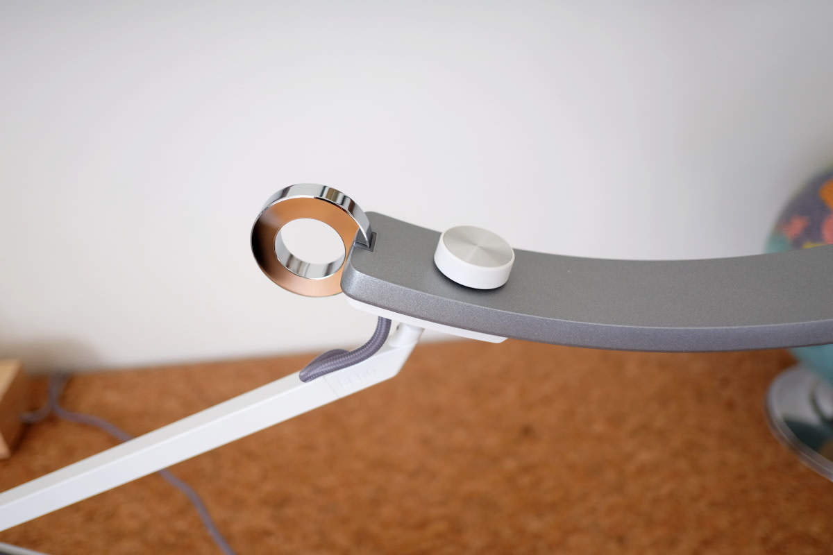 The chromed ring is a touch-activated on-off switch, and also controls the ambient light sensor mode.