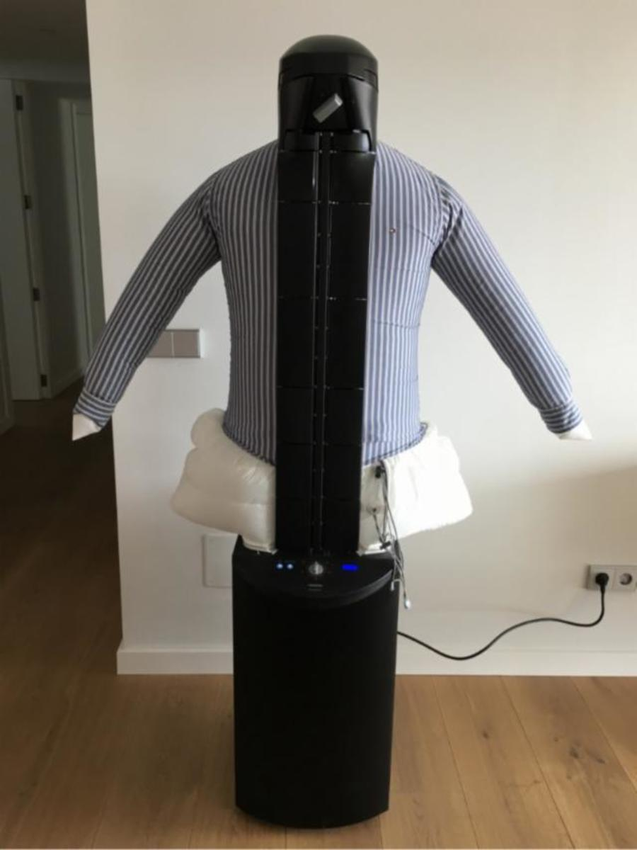 The Dressman robot at work ironing a shirt with ease.