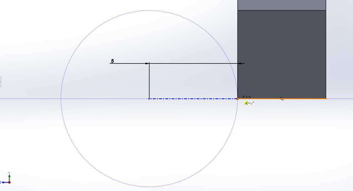 Placing the center of the Centerpoint Arc right on the Point we defined, then defining the radius by clicking on the lowest point of the part