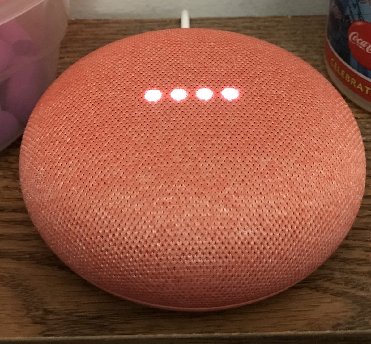 Coral (red) version of the Google Home Mini smart speaker