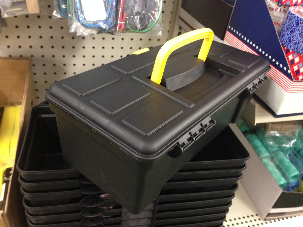 Dollar stores typically have a selection of cheap toolboxes.